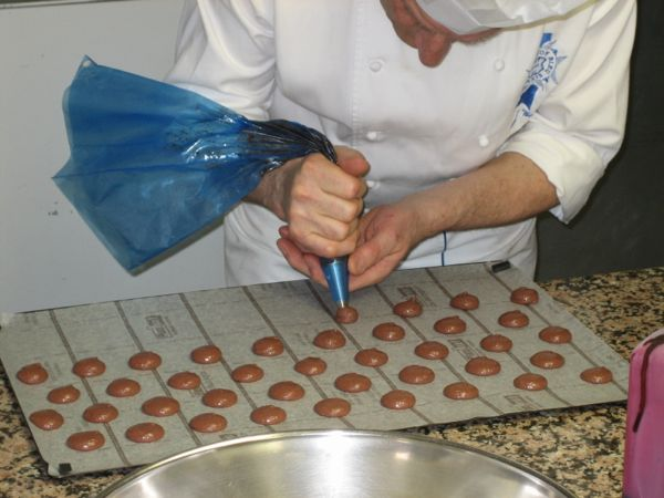 Making macarons at Cordon Bleu, Paris France. Book in advance
