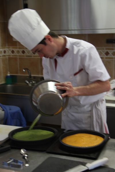 Mickeal pouring peas and carrots Ecole des Trois Ponts Riorges France