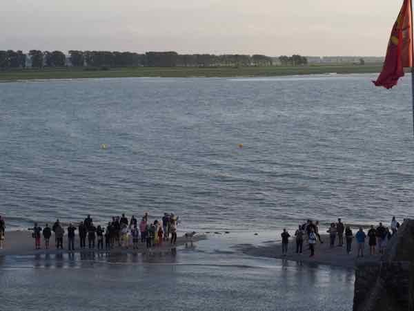 Incoming tide at Mont Saint-MIchel. J Chung