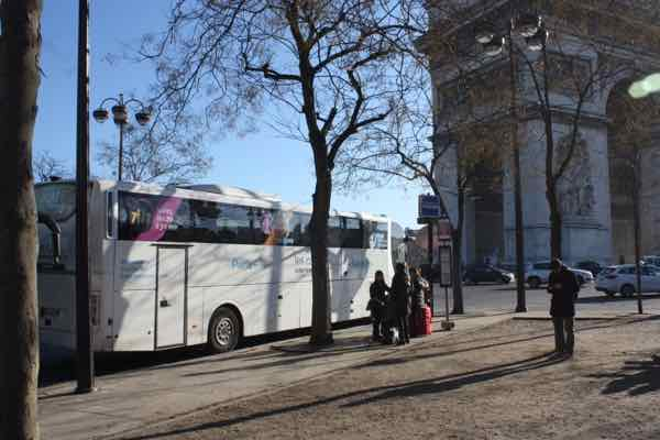 Le Bus Direct at the Arc de Triomphe, Paris. J Chung