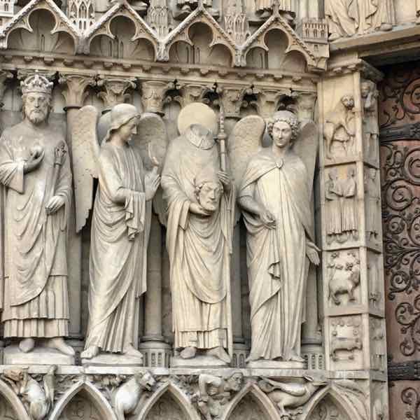 Saint Denis holds his head at Notre Dame. (Photo: J Chung)