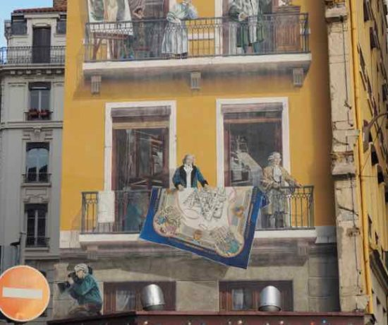 Lyon's Traboules and Wall Murals are everywhere. Here is the Fresque de Lyonnais (J. Chung)