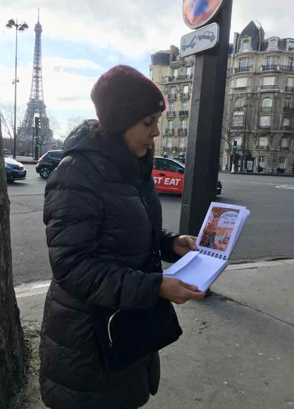 Monica checking out the clues at the beginning of our Paris In Action hunt