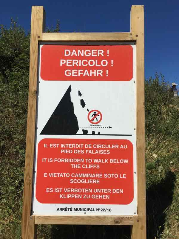Etretat cliff warning sign