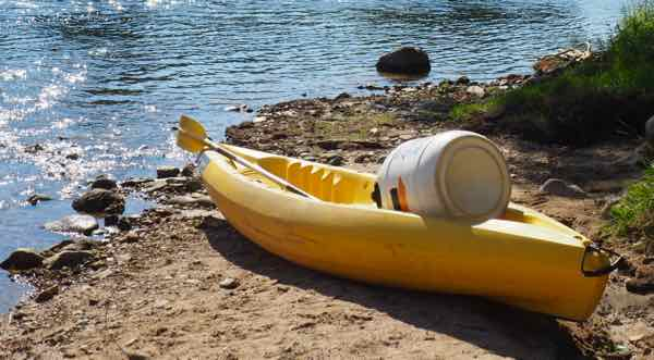 Kayak and waterproof container at the start