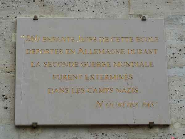 Plaque honouring 260 children who went to the school and were assassinated